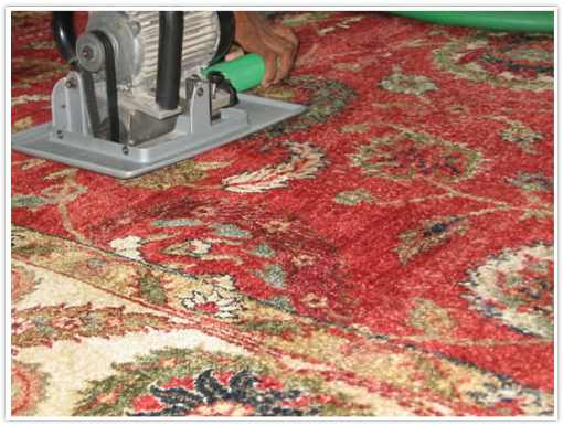 Hand-Operated Machine Clipping an Oriental Rug